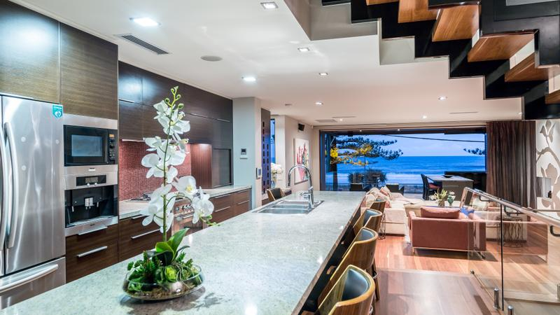 Tri-level Modern Masterpiece in Exclusive Beachfront Location (Harcourts Coastal)