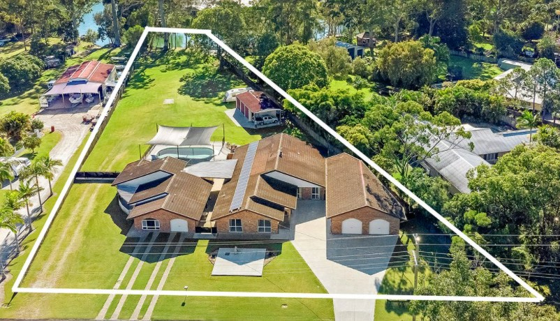 Currumbin Creekfront Acreage with Dual Living and Prime Potential (Harcourts Coastal)